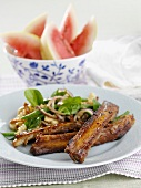 Pork ribs with pasta salad, watermelon wedges