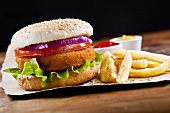 A fish burger with chips