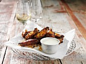 Grilled chicken wings with a dip