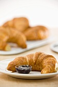 Croissants with forest fruits jam