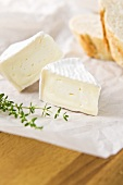 Two slices of camembert, thyme and a baguette