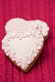 Two pink heart-shaped biscuits