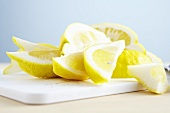 Lemon slices on a chopping board