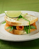 A toasted smoked salmon and rocket sandwich