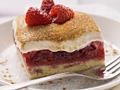 A piece of raspberry cake with sour cream-cream topping