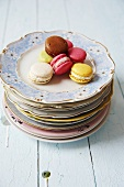 Colourful macaroons on a stack of plates
