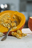 Removing the seeds from a Hokkaido squash