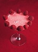 Raspberry milk shake in a martini glass