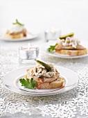 Veal schnitzel on baguette slices