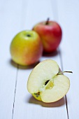 Two whole Braeburn apples and one half one