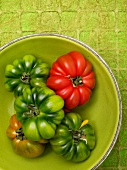 Tomatoes in a green bowl