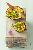 Asparagus tarts with green asparagus and diced ham