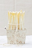 White asparagus spears in an old metal basket