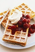Waffles with sour cherry sauce