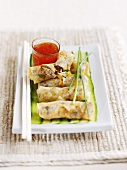 Five spring rolls filled with vegetables and herbs