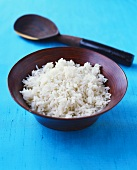 Cooked basmati rice in a wooden dish