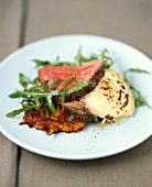 Venison fillet on rosti, rocket and bechamel potatoes