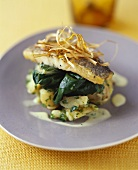 Zander fillet on spinach and potatoes