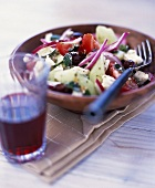Greek salad with a glass of wine