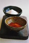 Two dishes of paprika and salt