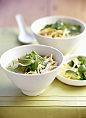 Asian chicken soup with soya sprouts and Thai basil
