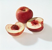 One whole white peach and two halves
