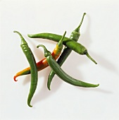 Several green chili peppers