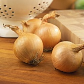 Four onions in a kitchen