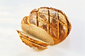 A loaf of bread with slices cut