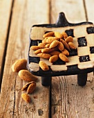 Almond kernels in chequered bowl
