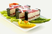 Tuna maki on green asparagus