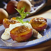 Grilled peach halves with brown sugar and cream