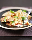 Lobster ravioli with tomato and cream sauce