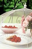 Fresh raspberries under a mosquito net