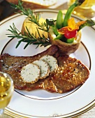 Lamb escalope with peppered butter, potatoes and asparagus