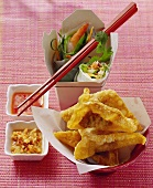 Deep-fried won tons and lucky rolls with dips