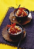 Two bowls of spicy chili and ginger relish