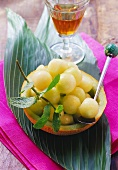Honeydew melon balls with a glass of sherry