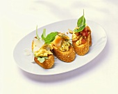3 crostini with egg, salmon, tomatoes & oyster mushrooms