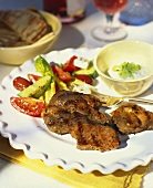 Barbecued pork steak with vegetable accompaniments