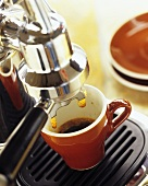 Espresso running into espresso cup
