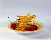 Lemon and ricotta pancakes with cherries and edible flowers