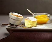 Two orange soufflés with preserved oranges