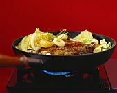 Porterhouse steak with cabbage in the frying pan