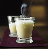 Two glasses of advocaat with hot milk and cream