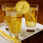 Three glasses of iced tea with slices of lemon