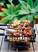 Beef and mushroom kebabs on a barbecue