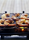 Several shrimps on a barbecue rack