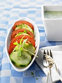 Cucumber and tomato salad in a boat-shaped dish