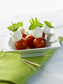 Cherry tomatoes with mozzarella and basil